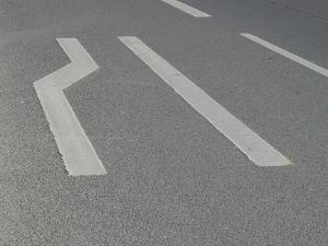 "They even paint the roads to show the drivers that a ""Fahrbahn Verengung-Einordnen-lassen-Reißverschlusssystem"" is in order."
