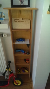 New shelf. This shelf fits perfectly in our little nook. Our daughter believes it's a place to keep her cars and trains, and so there you go. Photo: Laptops and Lederhosen