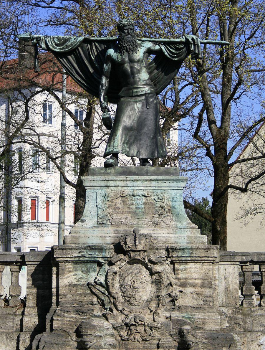 1200px-München_Schmied_von_Kochel_Denkmal1